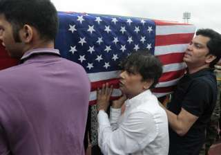 Relatives of Abinta Kabir, student of Emory University of U.S., carry her coffin draped with theBangladesh and U.S. flags after a ceremony for victims of the attack on the Holey Artisan Bakery, in Dhaka, Bangladesh.