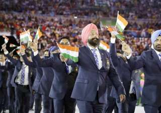 The members of the Indian contingent walk at the opening ceremony. The contingent saw most of the athletes but the tennis players, archers and wrestlers winners.