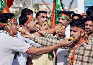 Supporters celebrate as early trends show the party's thumping win in the UP Election Results assembly polls, in Bikaner.