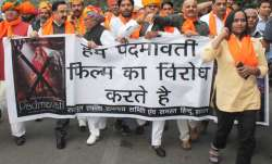 Members of Rajput community raise slogans and hold placards