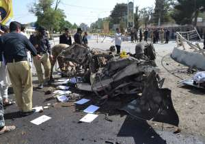 Pakistani police officers examine the site of an explosion- India Tv