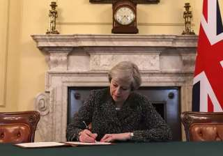 Theresa May signs the letter triggering Article...
