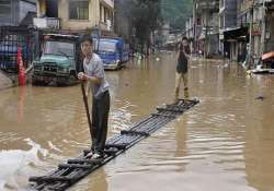 downpours leave 14 dead several missing in china