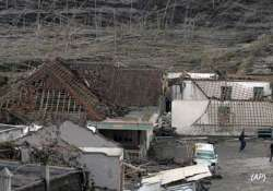 indonesia disaster toll hits 377 volcano erupts again