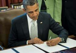 barack obama signs usd 1.1 trillion spending bill into law