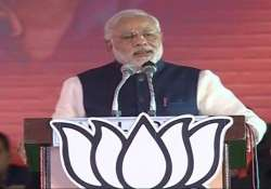 modi taunts congress for not naming rahul as pm candidate