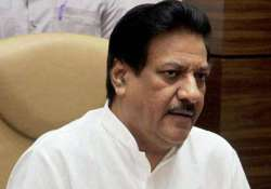 youth held for trying to hurl slipper at maharashtra cm