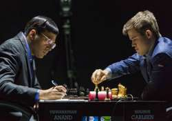 anand draws again carlsen inches closer to title