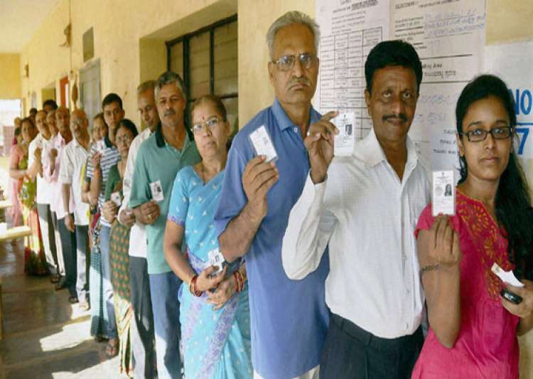 70.23 pc voter turn out estimated in peaceful karnataka polls- India Tv
