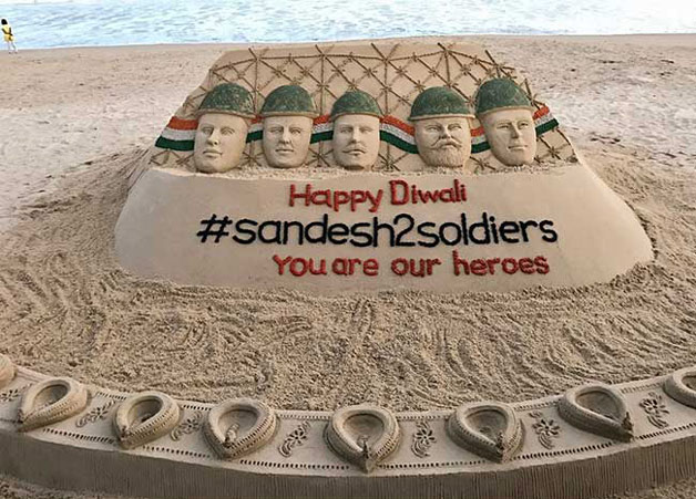 Sand artist Sudarshan Patnaik makes a sand art Happy Diwali dedicated to the Indian soldiers at Paradeep beach, Jagatsinghpur district of Odhisa.