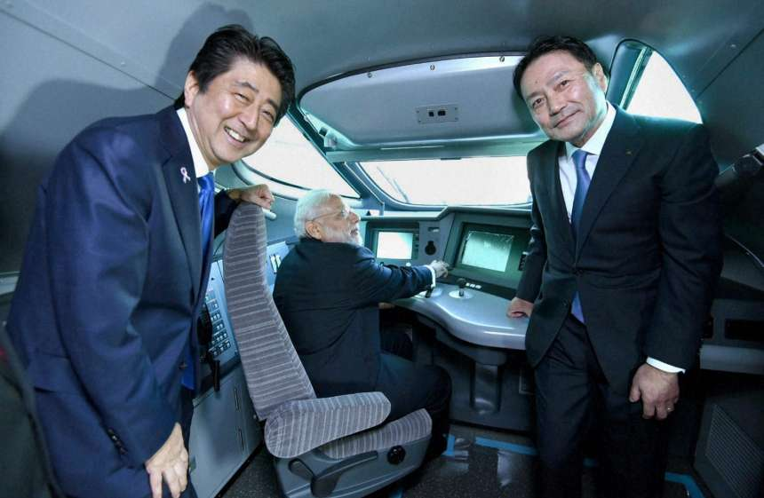 PM Modi sits on the pilot seat of a bullet train during his visit to Kawasaki Heavy Industries KHI Hyogo Plant in Kobe.
