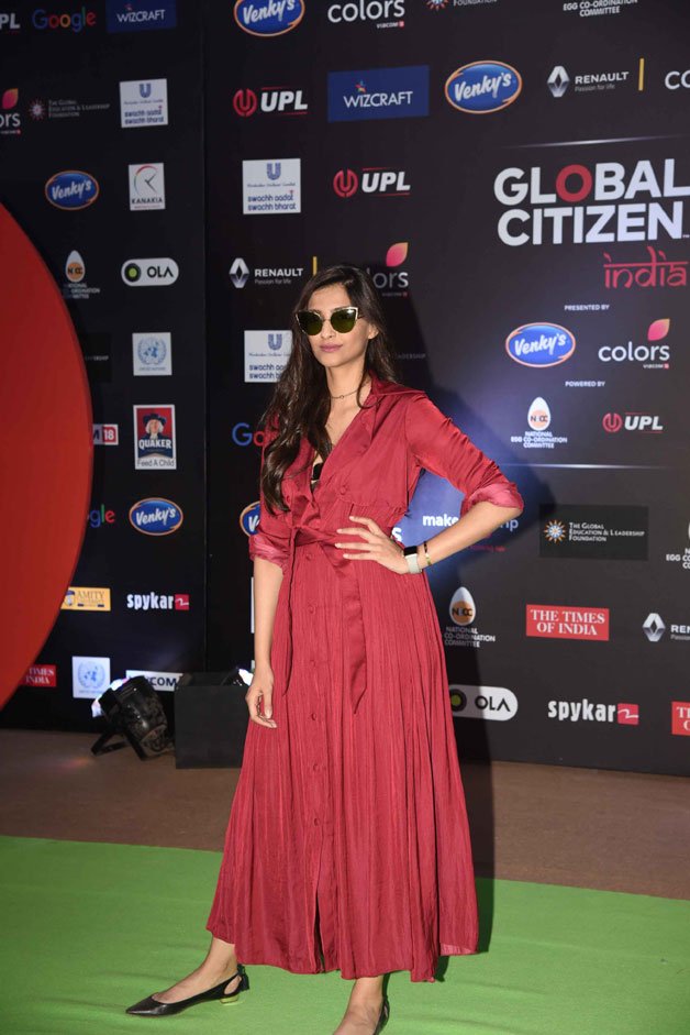 Actress Sonam Kapoor, who is known for her vibrant style sense, made another fashion statement as she wore a silk Sameer Madan trench dress with flats and cat-eye sunglasses.