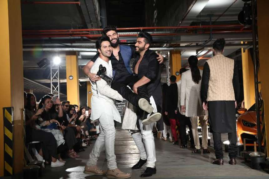 Varun took to the ramp and pulled Arjun from the sidelines to keep him company as he ended his long runway walk. The duo also lifted Kunal up on their shoulders for the shutterbugs at the end of the show that featured elegant menswear for which the designer is best known.