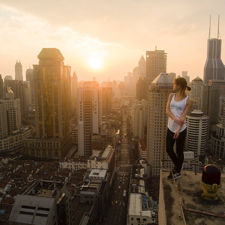 This 22-year-old Russian model, Angela Nikolau is defying the gravity by all means. This pretty-looking woman does immaculate yoga poses. And that's not all. She does them all at the top of some of Asia's tallest skyscrapers without a harness!