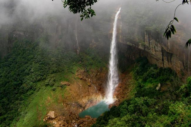 India's Highest but Tragic Waterfalls Nohkalikai, Meghalaya It is the highest plunge waterfall in India at a height of 115 feet. The story behind the name of these falls suggest that a woman named Ka Likai jumped to her death after husband killed her daughter and cooked up her remains into a meal. Her suicide gave the waterfall its name Nohkalikai which means 'Fall of Ka Likai'.