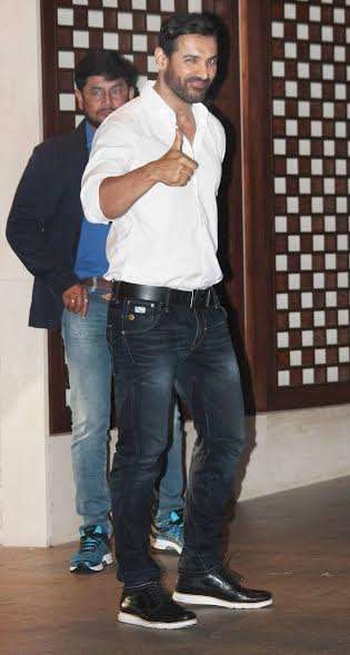 John Abraham looked suave in a white shirt and jeans.