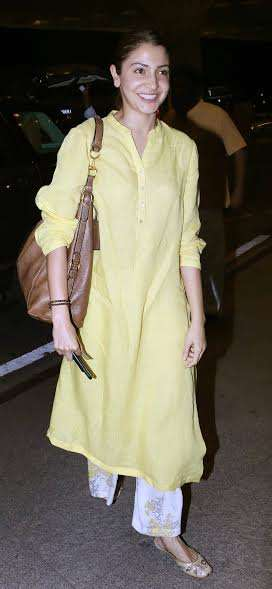 Phillauri actress Anushka Sharma wore a simple yellow kurti with a pair of good-lloking jutis to complete her look.