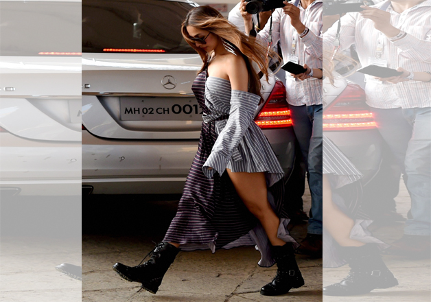 Bollywood actress Malaika Arora arrives for the Justin Bieber's concert in Mumbai on Wednesday. The actress looked stunning in her black and white stripes dress which she paired with black long boots.