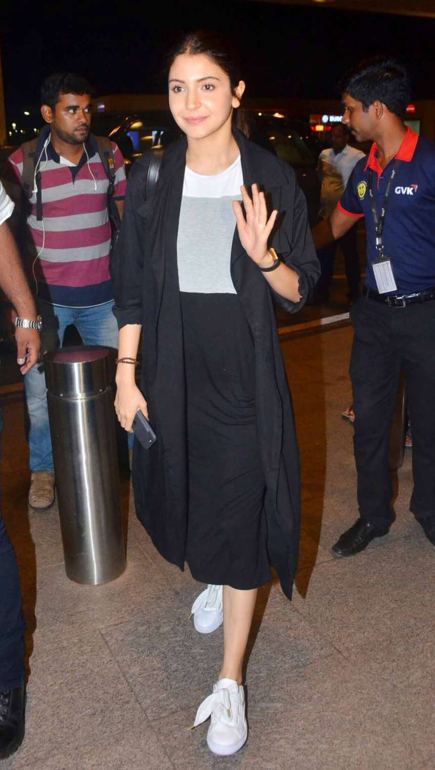 Anushka Sharma who's busy promoting her upcoming Jab Harry Met Sejal spotted in a black and grey skater dress with white sneakers and black shrug