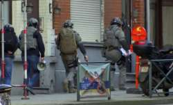 Belgium security personnel enter a building in Brussels in