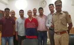 Army Major, Nikhil Handa (C) (in red t-shirt), arrested,