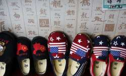 Chinese made children shoes carrying a Chinese map and U.S.