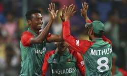 Al-Amin Hossain of Bangladesh celebrates after taking the