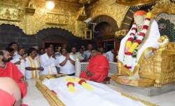 On eve of Karnataka bypolls counting, H D Deve Gowda at Saibaba temple