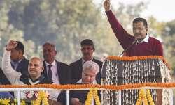 AAP chief Arvind Kejriwal raises slogans during his speech