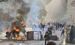 Vehicles set ablaze as protestors throw brick-bats during