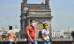 People wear protective masks in view of coronavirus
