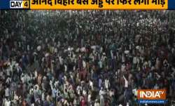 Migrant workers gather at Delhi's Anand Vihar bus stand to