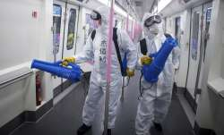 Healthcare workers in China disinfecting a metro train
