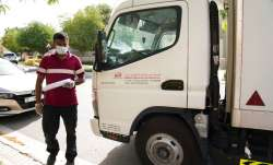 Delivery man leaves after dropping off alcohol at a home in Dubai, United Arab Emirates. Dubai's two