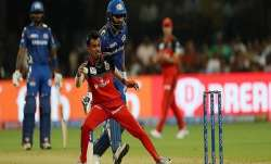 RCB's Yuzvendra Chahal in action against Rohit Sharm's