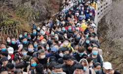 Thousands flock to China's Yellow Mountain after coronavirus lockdown is lifted