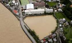 A schoolyard of a junior high school is seen flooded following heavy rains in Gero, Gifu prefecture,
