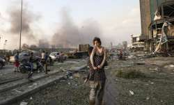 People evacuate wounded after of a massive explosion in Beirut, Lebanon, Tuesday, Aug. 4, 2020. (AP