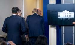 President Donald Trump is asked to leave the James Brady Press Briefing Room by a member of the U.S.