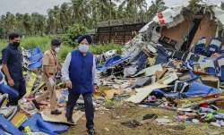 Union Civil Aviation Minister Hardeep Singh Puri inspects the crash site of an Air India Express fli