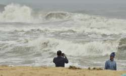 Chennai: A man clicks photographs as turbulent waves crash