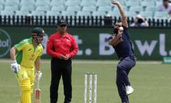 India's Mohammed Shami bowls as Australia's Aaron Finch