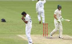 India's Shardul Thakur, left, celebrates the dismissal of