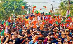 BJP leader Suvendu Adhikari during a roadshow from Mecheda