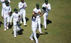 Pakistan bowler Hassan Ali ,centre, holds a cricket ball