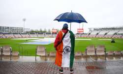 A India fan looks on as play is delayed on Day 1 of the ICC