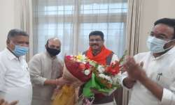 Basavaraj Bommai (in black facemask) has been named as new