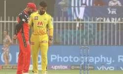 Captain Kohli chats with mentor Dhoni during Sharjah sandstorm