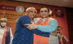 Gujarat Chief Minister Bhupendra Patel (L) and former CM