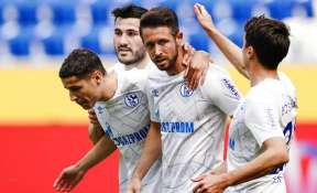 Schalke's scorer Mark Uth, second right, and his teammates celebrate a goal.